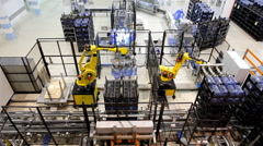 Robots loaders work in a warehouse bottled water. - stock footage