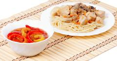 Italian spaghetti and appetizer bell peppers - stock photo