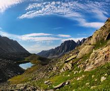 Cirrus clouds over the mountain tundra Stock Photos