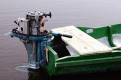 Outboard boat motor - stock photo