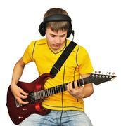 A teenager with an electric guitar Stock Photos