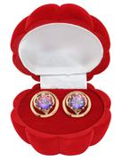 Gold earrings with rock crystal (quartz) - stock photo