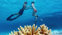 Romantic travel: young couple are swimming together Stock Footage