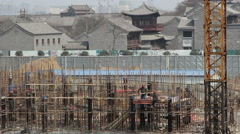workers on a construction site of Chinese traditional architectures - stock footage