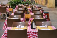 Serving tables in the  Italian outdoor  restaurant. - stock photo