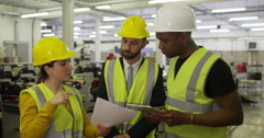 Warehouse manager discusses their business and checks stock levels Stock Footage