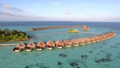 AERIAL: Overwater villas with private pools above the ocean Stock Footage