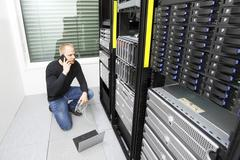 Problem solving IT consultant in datacenter - stock photo