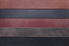 Natural leather belts close-up texture background - stock photo