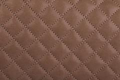 Light borwn quilted leather close-up Stock Photos