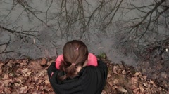 Girl Sitting Next To Forest Puddle, Brunches Reflection In Water, Fallen Leaves Stock Footage