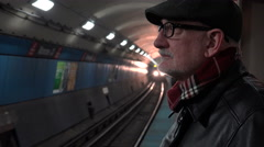 Passenger waiting for a subway train Stock Footage