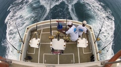 Men prepare rods and reels for fishing onboard fishing boat, Mauritius. Stock Footage
