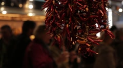 Dried Chilli hanging in market Stock Footage