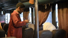 Interior of the bus with pilgrims in Axum Stock Footage
