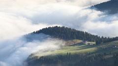Foggy summer sunrise in the Italian Alps. Ferchetta mountain range with rolli Stock Footage