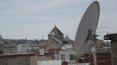 Tv Aerial with roof tops behind - stock footage