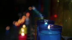Church Candles in coloured jars - stock footage