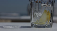 Cola being pour into glass on sunny day Stock Footage