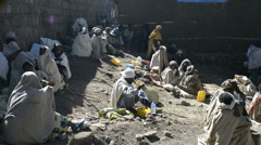 Christian pilgrims gathering and waiting for ceremony in Lalibela, Ethiopia Stock Footage