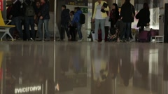 Slow angle shot of people in departure lounge Stock Footage