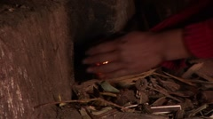 Farmer Woman making fire in kitchen, South America Stock Footage