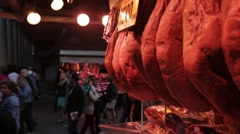 Ham, Bacon Hanging at market stall Stock Footage