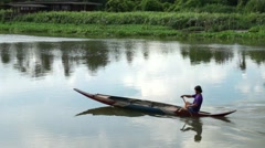 Fisherman age around 30-40s on boat are sailing on thai river - stock footage
