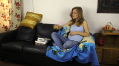 Pregnant woman sit on sofa drink healthy juice Stock Footage