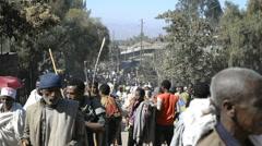 Pilgrims Pilgrims and local people on Main Street in Lalibela, Ethiopia Stock Footage