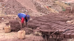 Adobe brick production, Peru Stock Footage