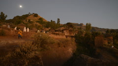 Ethiopia, Amhara Region, holy city of Lalibela, buildings at evening Stock Footage