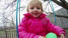 Child on swing Stock Footage