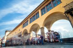 tourists visit famous Ponte Vecchio in Florence - stock photo