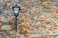 traditional stret lamp on old wall in Florence, Italy - stock photo