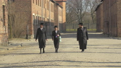 Stock Video Footage of Jews with robes at Auschwitz