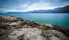 Rocky shore of the Adriatic Sea near Cavtat  in the cloudy morning, Croatia Stock Photos