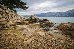 Rocky shore of the Adriatic Sea near Cavtat  in the cloudy morning, Croatia - stock photo