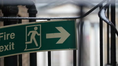 A Fire Exit signage on a steel gate Stock Footage