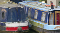 Abandoned blue boats docked on the port Stock Footage