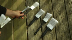 Paint brushes on ground 1 Stock Footage