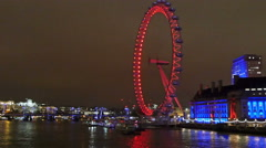 The red-lighted London Eye and the buildings at side Stock Footage