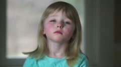 Sad litte girl looks at camera with tear Stock Footage