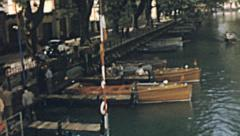 Annecy 1955: tourists waiting for a motorboat cruise Stock Footage