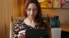 Woman browsing with tablet Stock Footage
