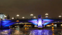 The calm and busy bridge in London at night Stock Footage