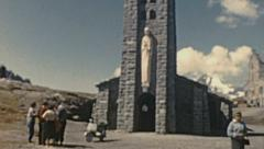 France 1955: people visiting a small church in the Alps Stock Footage