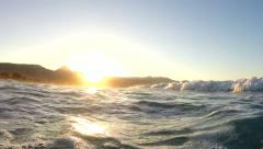 Waves on a beach at sunset Stock Footage