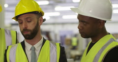 Manager gives instructions to his coworkers and discusses business logistics.  - stock footage