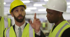Warehouse manager gives instructions to his foreman and discusses logistics. Stock Footage